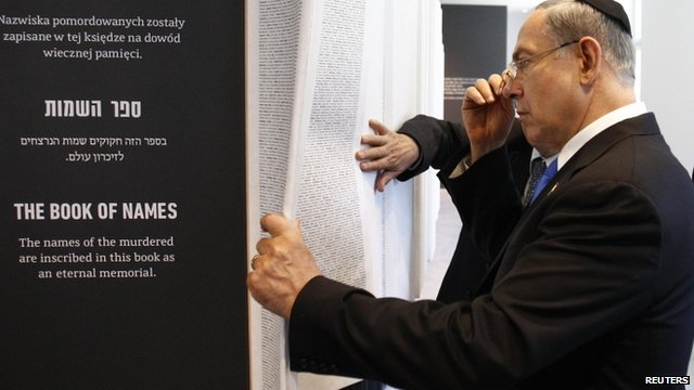 """Israel""""s Prime Minister Benjamin Netanyahu looks at """"The Book of Names"""" at the Auschwitz-Birkenau State Museum in Oswiecim"""