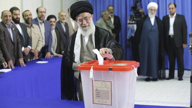 "Iran""s Supreme Leader Ayatollah Ali Khamenei casts his ballot at his office during the Iranian presidential election in central Tehran"