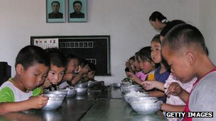 File photo: North Korean children eat lunch at a government-run kindergarten at Taedong county, south Pyongan province, North Korea, 19 July 2005