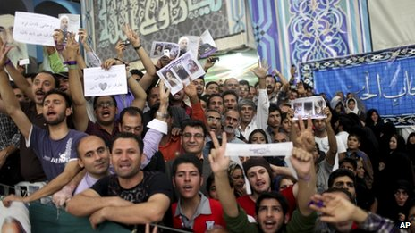 Supporters of Iranian President elect Hassan Rouhani, react, as he visits the shrine of the late revolutionary founder Ayatollah Khomeini, just outside Tehran