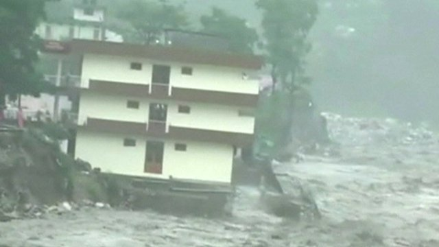 Apartment building surrounded by flood water in Uttarkashi in Uttarakhand state