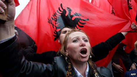A supporter of the nationalistic party Red and Black Alliance protests in front of the government HQ in Tirana, 7 Apr 13