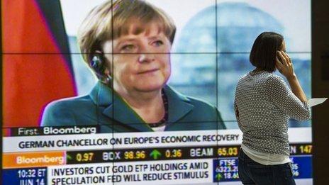Merkel on screen in lobby of IMF building