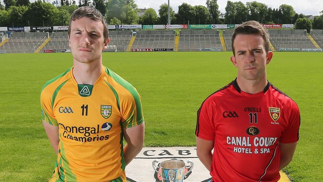 Donegal's Leo McLoone with Down's Mark Poland
