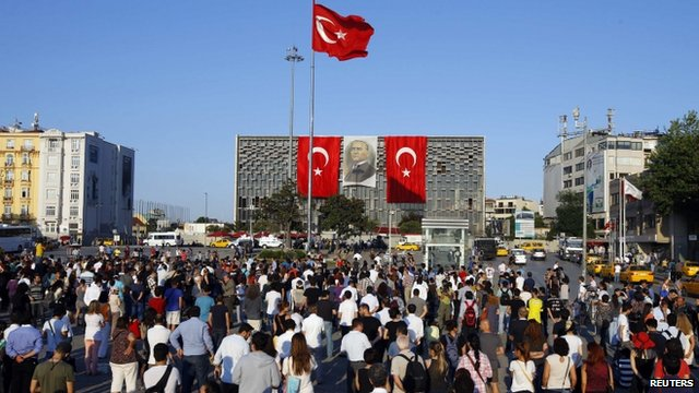 Protesters in Istanbul's Taksim Square, facing Ataturk Cultural Center