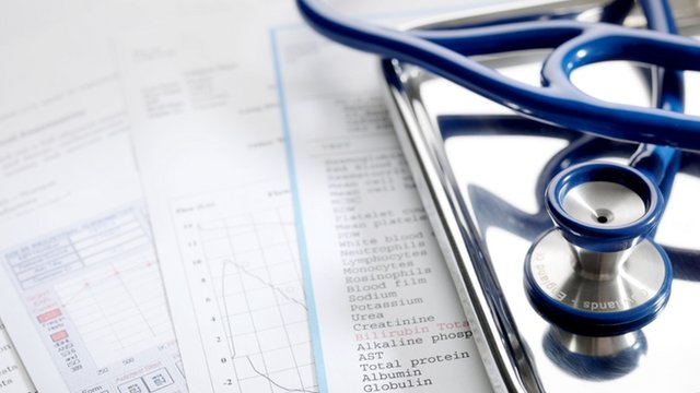 Health check results, inc blood test results with stethoscope