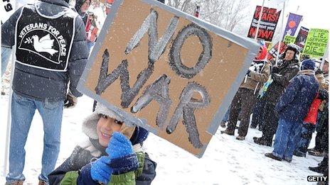 Protestor holding an anti-war sign in Washington