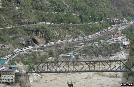 Stranded vehicles stand in queues after heavy rains in the Himalayan state of Uttarakhand June 17, 2013