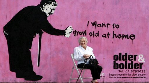 Mabel Gargan in front of a poster she helped to create