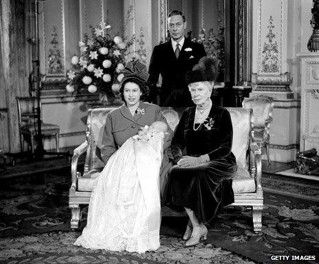 Elizabeth holding Charles in the christening robe