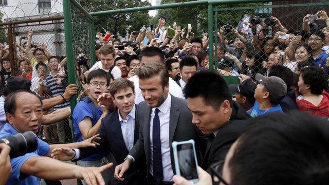 Crowds surround David Beckham