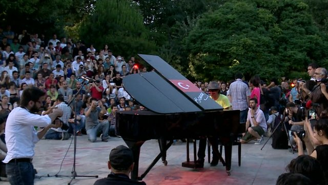 Protester playing the piano
