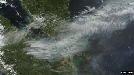 A Nasa satellite image shows smoke from forest fires in Sumatra blown eastwards to southern Malaysia and Singapore, 19 June 2013