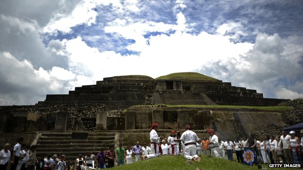 People take part in a Mayan ceremony to celebrate the summer solstice before an ancient Mayan temple