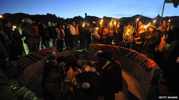 Aymara natives gather at sunrise to celebrate the winter solstice, which marks the Aymara New Year, at the Valley of the Moon, near La Paz, on June 21, 2012.