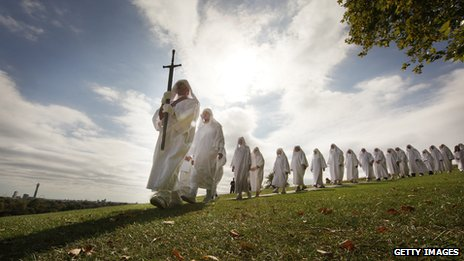 Druids dressed in white march in single file on Primrose Hill to celebrate the Autumn equinox