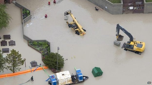 Flood waters surround the hospital in Canmore, Alberta
