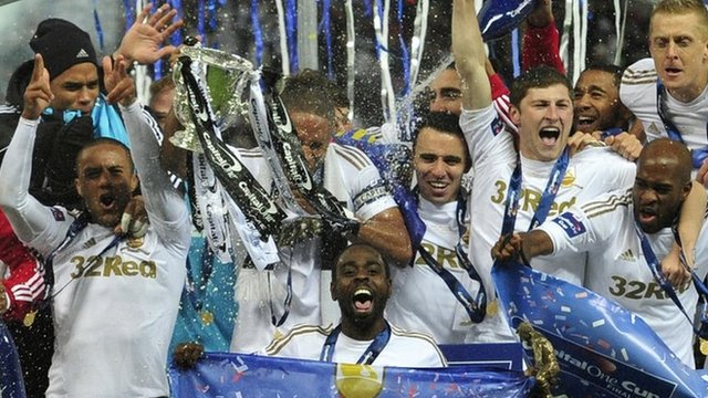 Swansea City celebrate winning the League Cup