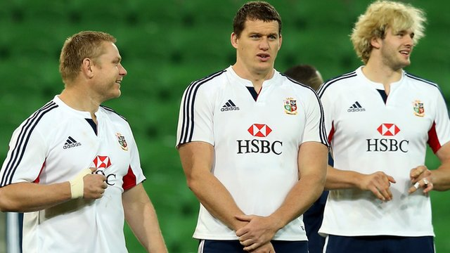 Tom Court with fellow Lions players Ian Evans and Richie Gray in Melbourne