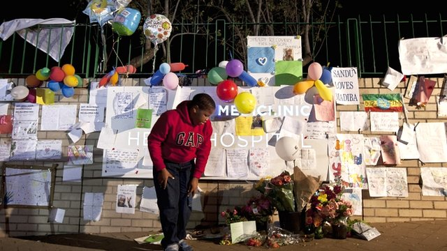 Messages and flowers left outside the hospital where Nelson Mandela is being treated