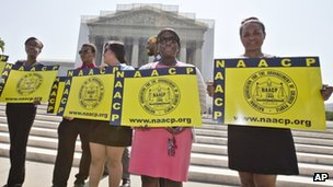 Supporters of the Voting Rights Act demonstrate outside the US Supreme Court in Washington DC on 25 June 2013