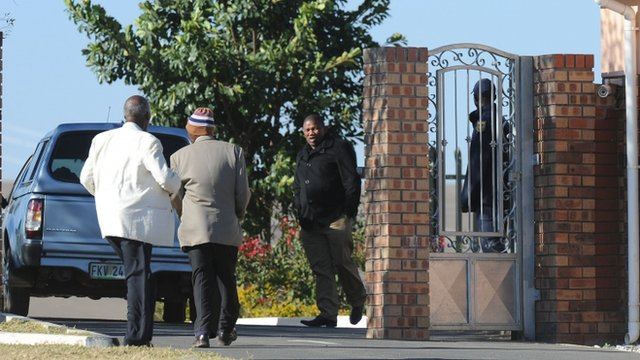 Pedestrians and a vehicle are seen at the entrance to the home of former president Nelson Mandela in Qunu, South Africa