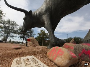 Memorial for Miguel Martinez next to a bull statue at the National Ranching Heritage Center, at Texas Tech University (25 June 2013)