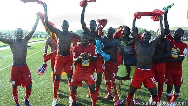 Asante Kotoko players celebrate winning the Ghanaian league title