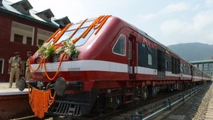 A train adorned with garlands is pictured at the platform for a flagging off ceremony attended by Indian Prime minister Manmohan Singh and Congress party President Sonia Gandhi for a train service running between Banihal and Qazigund at a station in Banihal, some 110 kms south of srinagar, on June 26, 2013.