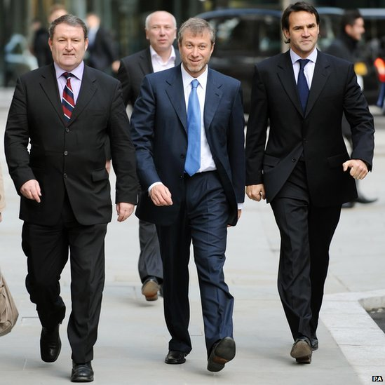 Chelsea FC owner Roman Abramovich (centre) outside the Royal Courts of Justice in central London where gave evidence in his battle with exiled Russian oligarch Boris Berezovsky