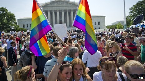 People celebrate outside the Supreme Court after two historic gay marriage rulings in Washington DC 26 June 2013