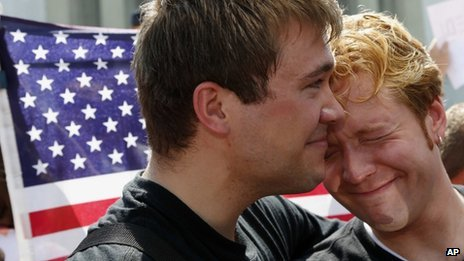 A gay couple celebrate the Supreme Court rulings on gay marriage in Washington DC 26 June 2013
