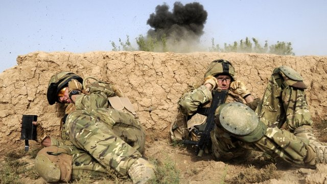 British troops take cover as they shelter from a controlled explosion of an Improvised Explosive Device in Helmand.