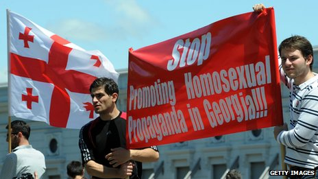 Two men in Georgia holding an anti-gay banner