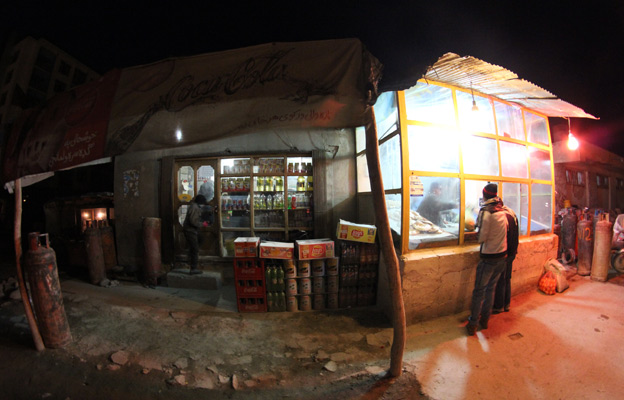 A baker and grocery store in Kabul at night