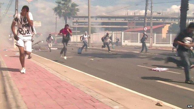 People apparently fleeing tear gas in Fortaleza, Brazil
