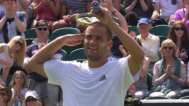 Mikhail Youzhny celebrates his third round victory