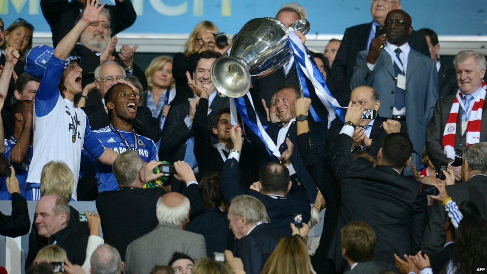 Chelsea's Russian owner Roman Abramovich holds the trophy after the UEFA Champions League final between Bayern Munich and Chelsea on 19 May, 2012 at the Fussball Arena in Munich
