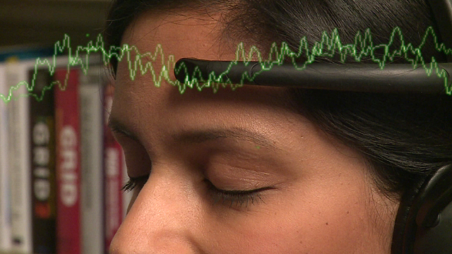 Sumi Dais wearing a headset that can monitor brainwaves