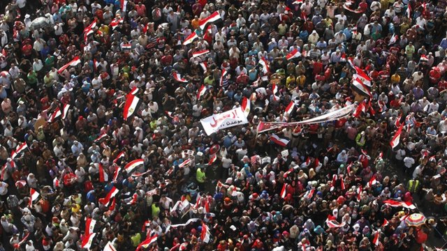 "Anti-Mursi protesters carry a banner saying ""leave"""