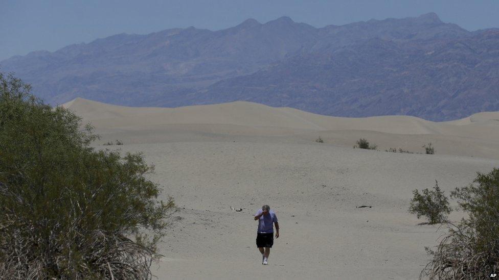 Man walks through Death Valley, California (28 June 2013)