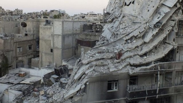 A view of buildings damaged by what activists say was shelling by forces loyal to President Bashar al-Assad in the Khalidiya neighbourhood of Homs on Friday