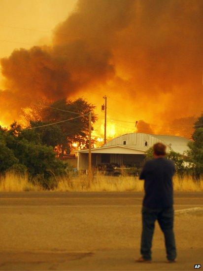Man watches fire burn in Yarnell (30 June 2013)