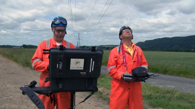 Men operating a drone