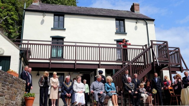 Prince Charles and the Duchess of Cornwall at the Boathouse in Laugharne to watch the performance