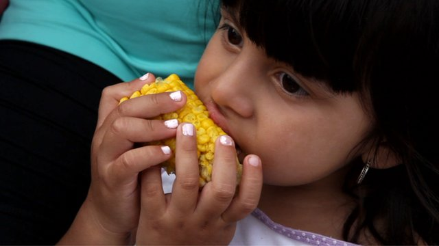 Eating corn on the cob at Coney Island