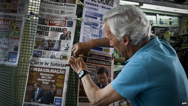 Man with newspapers in Portugal