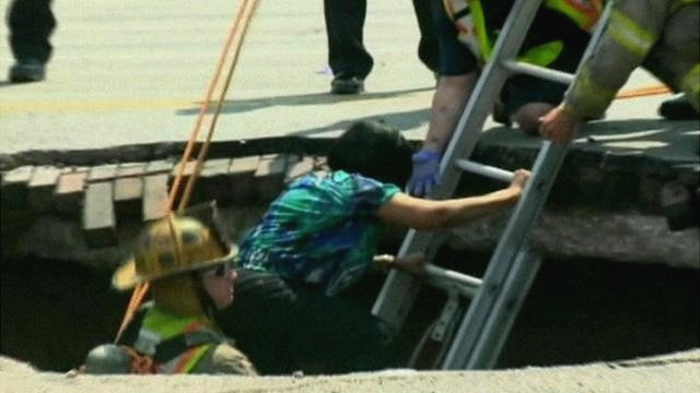 Woman escapes sinkhole