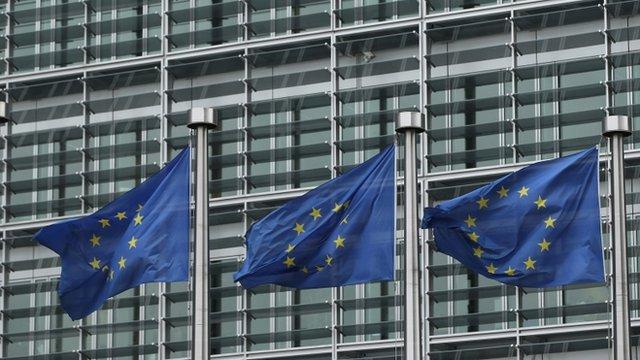 European Union flags blow in a breeze