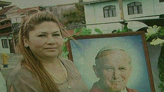 Floribeth Mora with framed image of Pope John Paul II